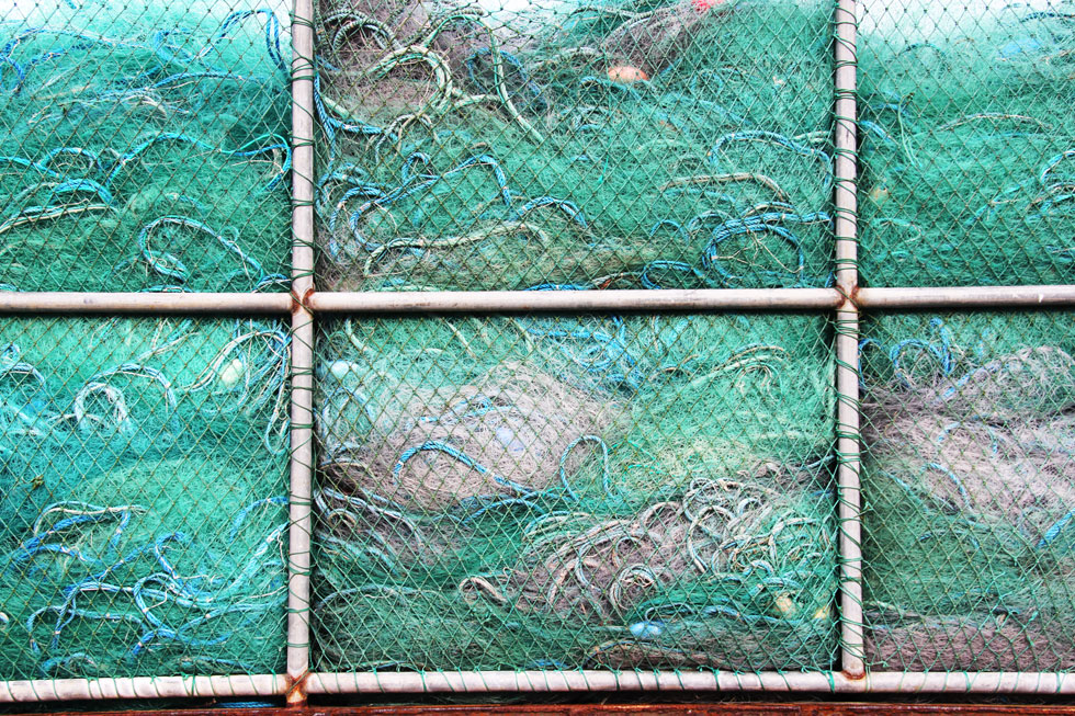 Disappearing lakes: From Aral Sea (central Asia) to Great Lakes (north America) - disused fishing nets.